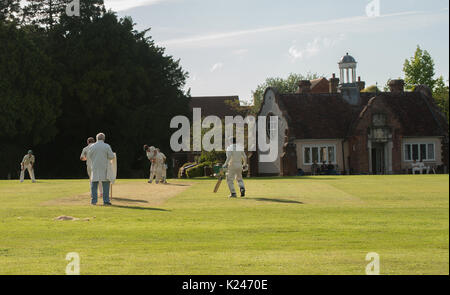 Village cricket at Benenden in Kent on a sunny summers evening on the village green - Stock Photo