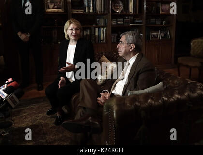 Former president of Costa Rica and Nobel Peace Prize winner Oscar Arias (R) meets with former Venezuelan attorney - Stock Photo
