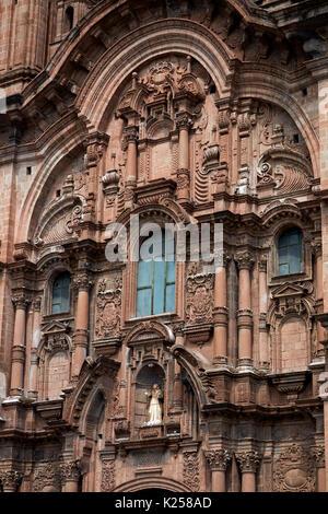 Ornate facade on Iglesia de la Compania (built 1605-1765), Plaza de Armas, Cusco, Peru, South America - Stock Photo