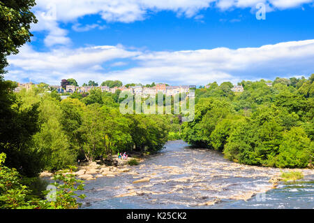 A view down the River Swale on a beautiful summer's day, Richmond, North Yorkshire, England, UK - Stock Photo