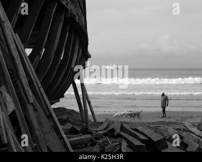 Wooden made fishing boat being manufactured or repaired in Manta - Murciélago Beach - Ecuador - Stock Photo
