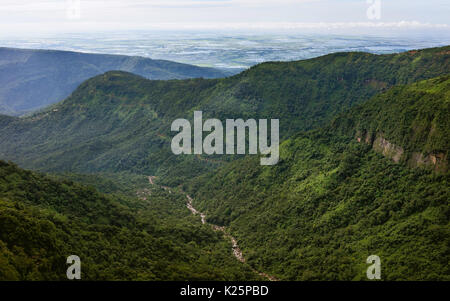 View along the Khasi hills and river with the rugged slopes of forest and peaks and the border with Bangladesh in - Stock Photo