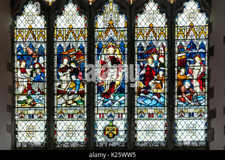 Stained glass in St Nicholas church, New Romney, Kent - Stock Photo