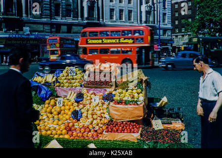 Fruit seller outside Marble Arch's Odeon Cinema. Image taken in 1959 A moment in time captured with a fruit and - Stock Photo