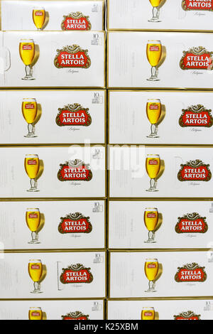 Boxes of Stella Artois lager cans on a British supermarket shelf - Stock Photo