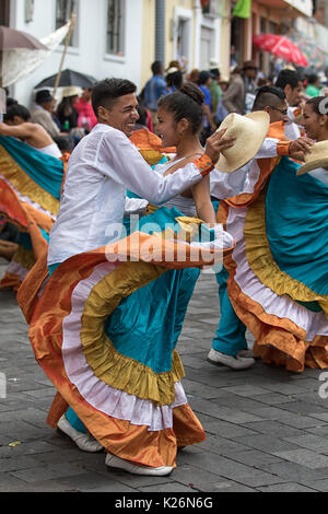 June 17, 2017 Pujili, Ecuador: indigenous couple dancing in colonial style dress at the Corpus Christi annual parade - Stock Photo