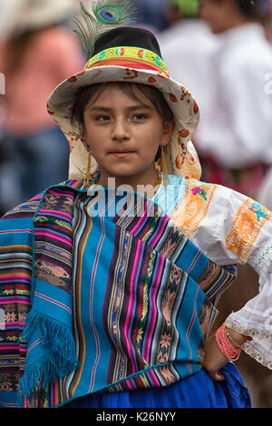 June 17, 2017 Pujili, Ecuador: young indigenous girl in bright color traditional clothing at Corpus Christi parade - Stock Photo