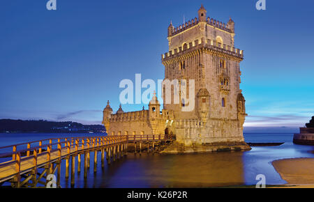 Medieval Belem Tower at night - Stock Photo