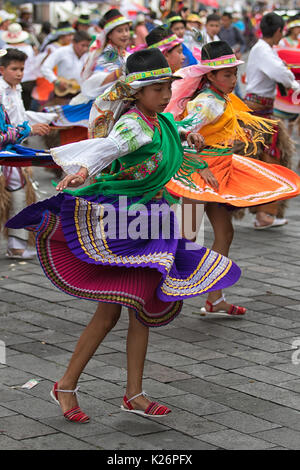 June 17, 2017 Pujili, Ecuador: female dancers dressed in traditional clothing in motion at the Corpus Christi annual - Stock Photo