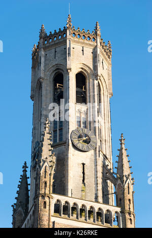 The Belfry Tower, aka Belfort, of Bruges, medieval bell tower in the historical centre of Bruges, Belgium. Close - Stock Photo