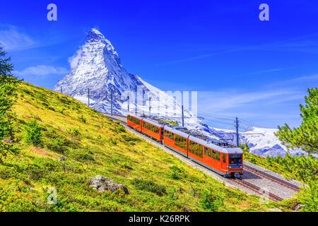 Zermatt, Switzerland. Gornergrat tourist train with Matterhorn mountain in the background. Valais region. - Stock Photo