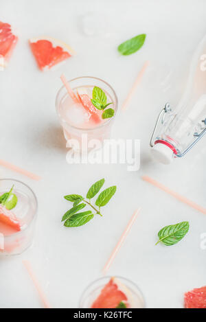 Cold refreshing summer alcohol cocktail with fresh grapefruit - Stock Photo
