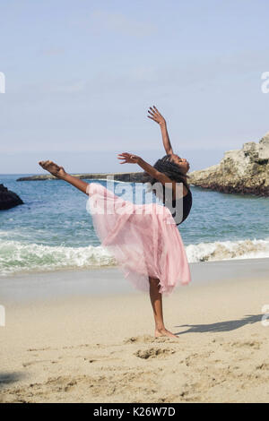 Dancer in pink skirt on the beach - Stock Photo