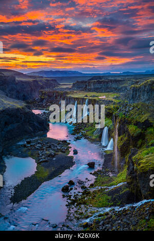 Canyon with multiple waterfalls in the Southern Region of Iceland - Stock Photo