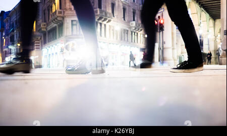 People walking on the street, night in Turin Italy - Stock Photo