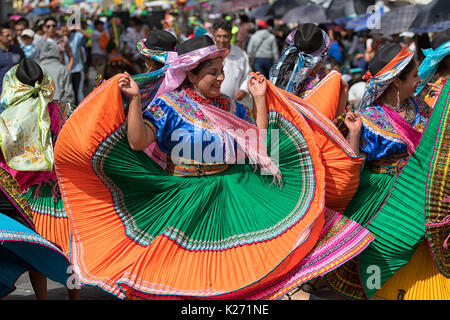 June 17, 2017 Pujili, Ecuador: female dancer in traditional clothing in motion at the Corpus Christi annual parade - Stock Photo