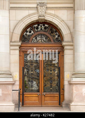 Stunning entrance / arched door of Glasgow City Chambers / town hall with decorative wrought iron design over glass - Stock Photo