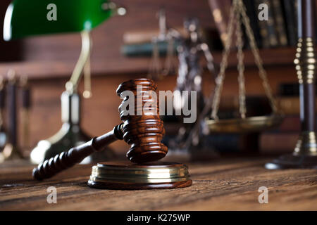 Law and justice. Judge's gavel, books and scale on wooden table table. Place for typography. - Stock Photo