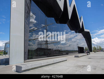 Large and unusual building displaying modern architecture with huge wall of dark glass, Riverside museum of transport - Stock Photo
