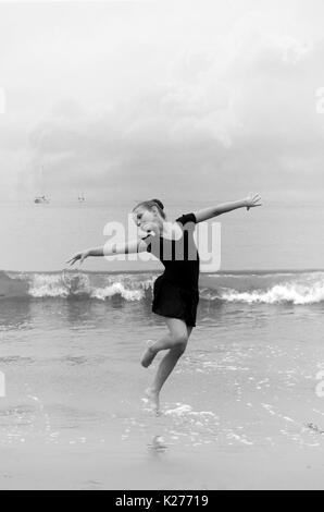 Young dancer in waves - Stock Photo