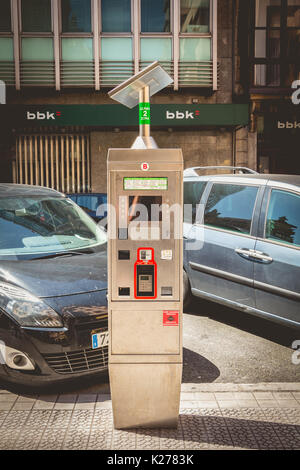 BILBAO, SPAIN - July 19, 2016 : In the street, a park meter powered by a solar panel in the city of Bilbao, Spain - Stock Photo