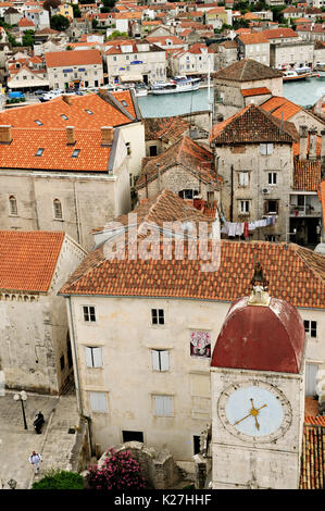 Clock tower in the old town of Trogir, Croatia - Stock Photo
