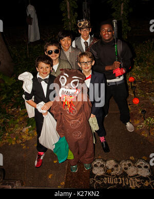 Halloween teenage trick or treaters dressed in various costumes. St Paul Minnesota MN USA - Stock Photo