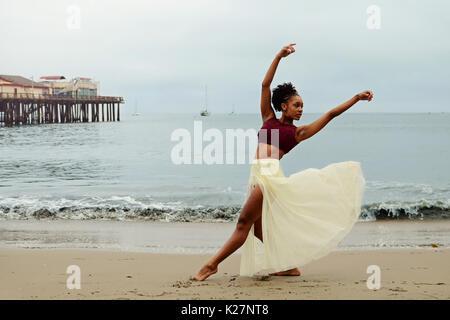 Lyrical dancer at beach - Stock Photo