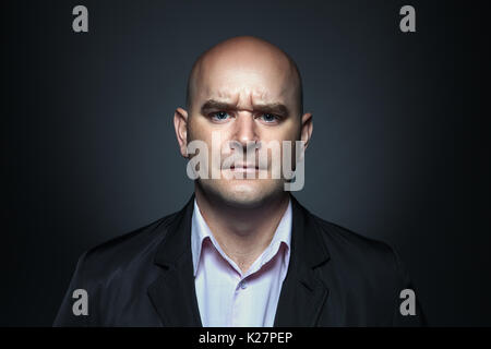Portrait of a man with angry expression - Stock Photo