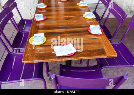 Miami Beach Florida restaurant sidewalk table purple chair place settings - Stock Photo