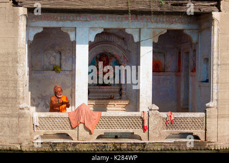 Asia,India,Uttar Pradesh,Varanasi district. Sadhu prayng - Stock Photo