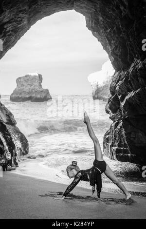 Young dancer in a cave - Stock Photo