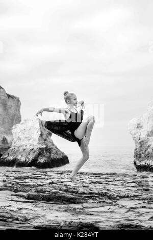 Little dancer on rocks - Stock Photo
