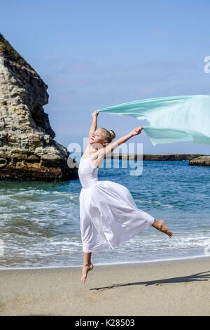 Dancer leaps with scarf - Stock Photo