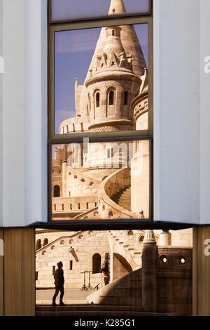 Budapest, Hungary. Fisherman's Bastion reflected in the opposite building.
