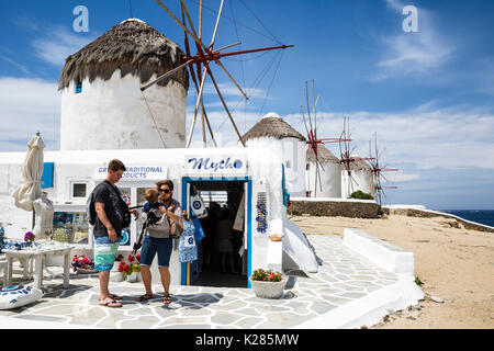 Tourists at a souvenir shop next to the Kato windmills, Mykonos, Greece. - Stock Photo