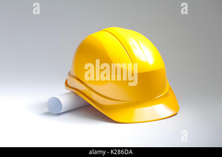 Yellow safety helmet with drawings - Stock Photo