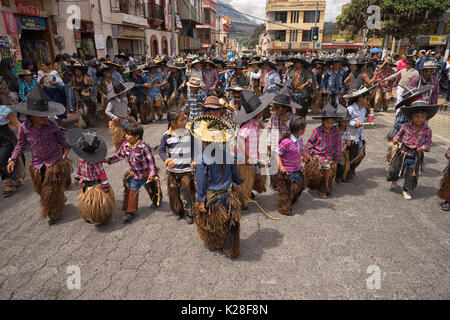 June 25, 2017 Cotacachi, Ecuador: children wearing sombreros and chaps at the the Inti Raymi celebrations - Stock Photo