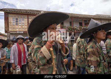 June 25, 2017 Cotacachi, Ecuador: indigenous kichwa man using the seashell horn at the Inti Raymi parade - Stock Photo