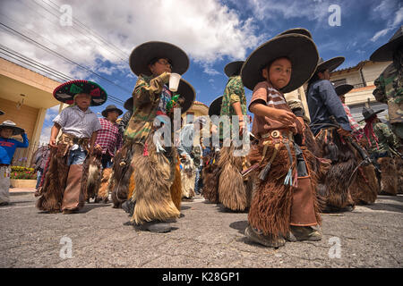 June 25, 2017 Cotacachi, Ecuador: all ages are represented at the Inti Raymi parade in the indigenous kichwa town - Stock Photo