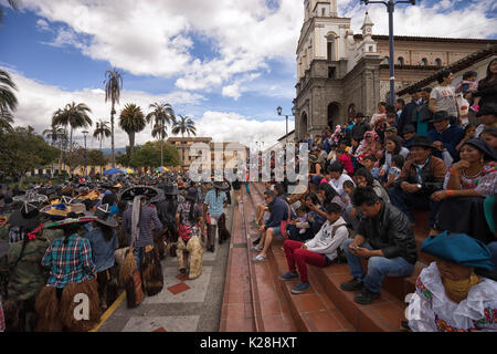 June 25, 2017 Cotacachi, Ecuador: spectators stting on the stairs of the church in the main plaza watching the Inti - Stock Photo