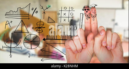 Composite image of digital image of anthropomorphic smiley faces on fingers - Stock Photo