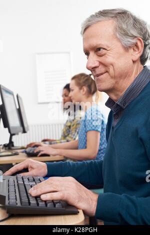 Mature Man Attending Computer Class - Stock Photo