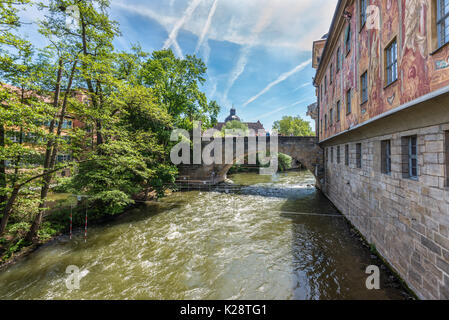 Bamberg, Germany - May 22, 2016: The wall of the old town hall and bridge in downtown of Bamberg, Upper Franconia, - Stock Photo