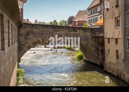 Bamberg, Germany - May 22, 2016: Old bridge over the Regnitz river in downtown of Bamberg, Upper Franconia, Bavaria, - Stock Photo