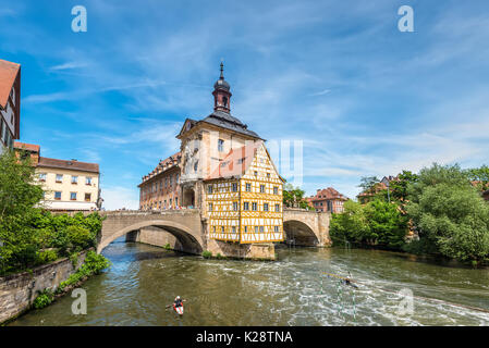 Bamberg, Germany - May 22, 2016: Scenic spring wide-angle view of the Old Town architecture with City Hall building - Stock Photo