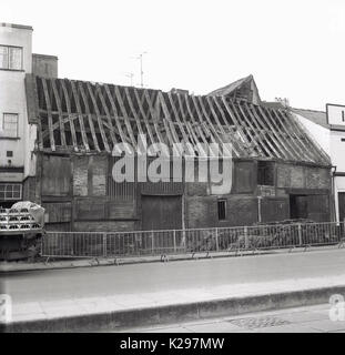 1960s, historical, picture shows exterior view of an ancient brick built storage barn in an english market town - Stock Photo