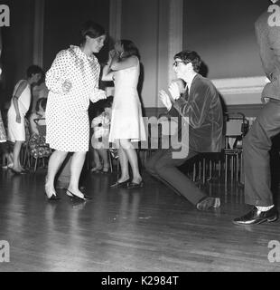 1964, historial, England, UK, the new dnace craze, picture shows a boy and girl dancing solo to the new sounds of - Stock Photo