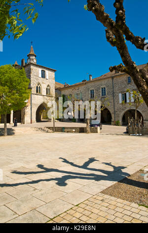 A picturesque corner of the central square in Monflanquin, Lot-et-Garonne, France. Monflanquin is thought to be - Stock Photo