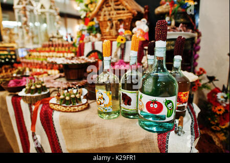 Alcohol bottles on wedding banquet table. - Stock Photo